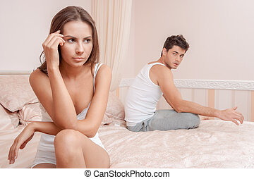 Young couple in a bed bored woman