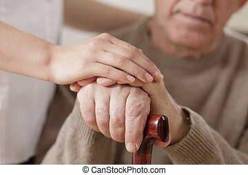 Woman and man holding hands - Young woman and old man...