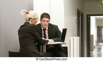 Woman and man in a meeting