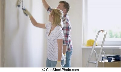 Woman and man makes repairs