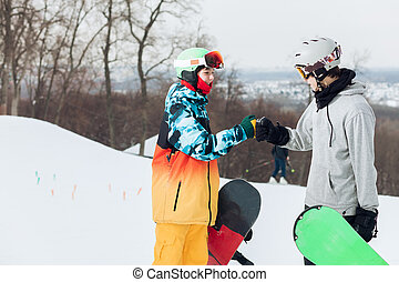 woman and man making friends during winter vacation