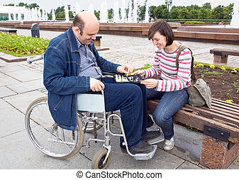 woman and man on an wheelchair