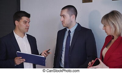 Concept of discussing small business. Mature businessperson standing in conference room or coworking space office. Woman and man in formal wear clothes planning new business or startup strategy