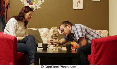 Woman and man playing boardgame Jenga