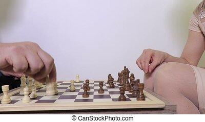 Woman and man playing chess