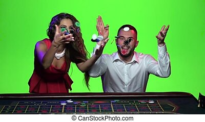 Woman and man playing in the casino win. Slow motion