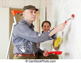 woman and man repairs at home