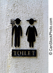 Woman and man restroom sign