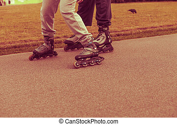 Woman and man, rollerblading exercises, no face - Active...