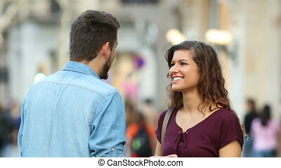 Woman and man talking in the street