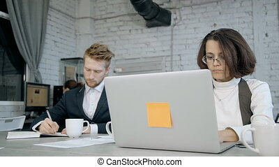 Woman and man using laptop, agenda and working in office -...