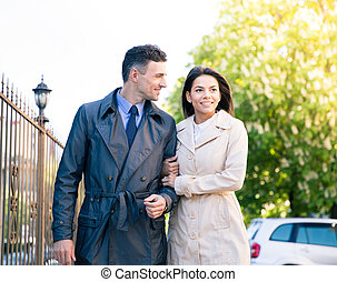 Woman and man walking outdoors