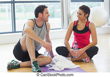 Woman and man with water bottles ch