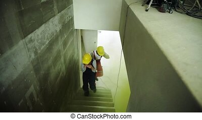 Woman and man workers suffocating at the construction site....