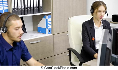 Woman and man working at customer support line