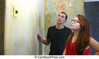 woman and man working family lifestyle house painter paints wall repairs in apartment
