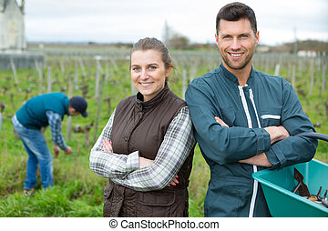 woman and man working in the vineyard