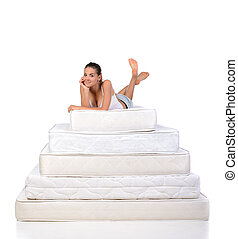 Woman and mattress - Portrait of a woman lying on many...
