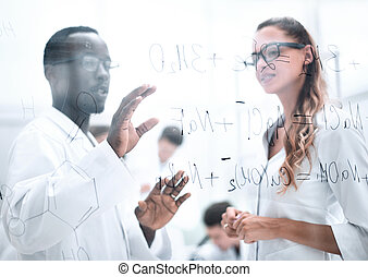Woman and men scienist in laboranory