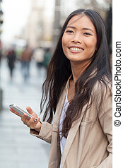 Woman and mobile phone