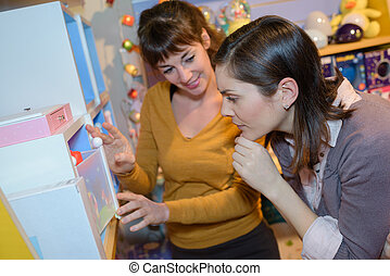 woman and mother in toy shop