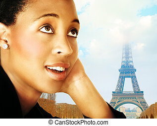 Woman and Paris - Young African woman in business suit...