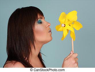 woman and pinwheel
