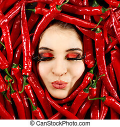 Woman and red chili pepper