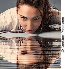 Woman and reflection