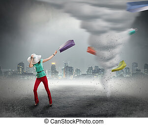 Woman and shopping tornado - Woman stands near tornado with ...
