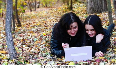 Woman and teenager with laptop
