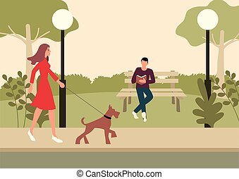 Woman and terrier dog walking in the park