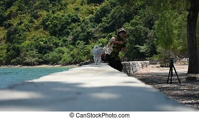 Woman and the dog at beach - Asia woman plump body in...