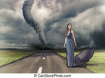 woman and tornado - woman,with umbrella on the road and...