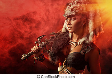 woman and weapon - Beautiful bellicose Amazon with a sword...