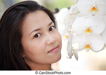 woman and white orchid