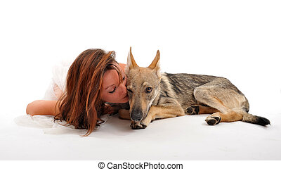 young woman and her puppy slovakia wolf sleeping together