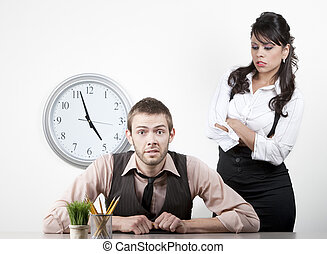 Woman at work wngry with male coworker