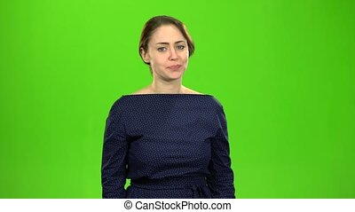 Woman angry with her friend. Green screen - Woman looks at...
