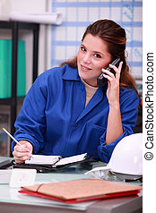 woman answering the phone in a office