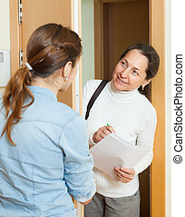 woman answers the questions in door