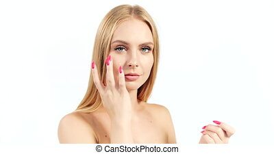 Woman Applying Cream on Face - Attractive blonde woman...