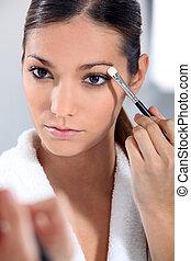 Woman applying eye make-up