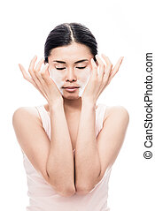 Woman applying facial moisturizer cream for sensitive skin