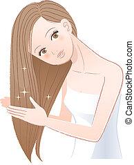 Woman applying hair oil to her long hair