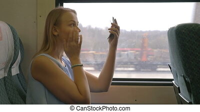 Woman Applying Make-up in Train