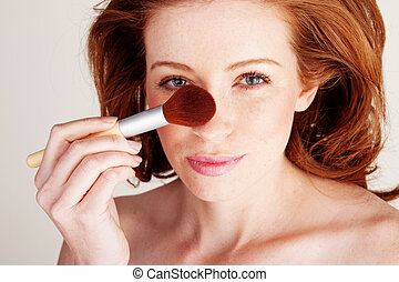 Woman Applying Makeup With Large Brush