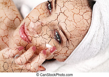 Woman applying moisturizing cream on her face
