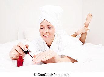 woman applying polish