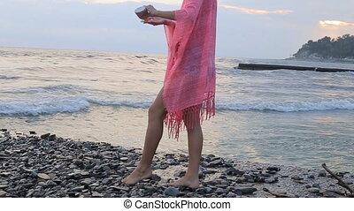 Woman applying suntan cream. Close up view on the legs.